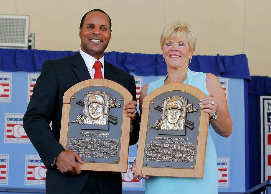 Barry Larkin and Vicki Santo, widow of inductee Ron Santo, enjoyed an emotional afternoon at the Baseball Hall of Fame induction ceremony on Sunday. Photo: Jim McIsaac / 2012 Getty Images