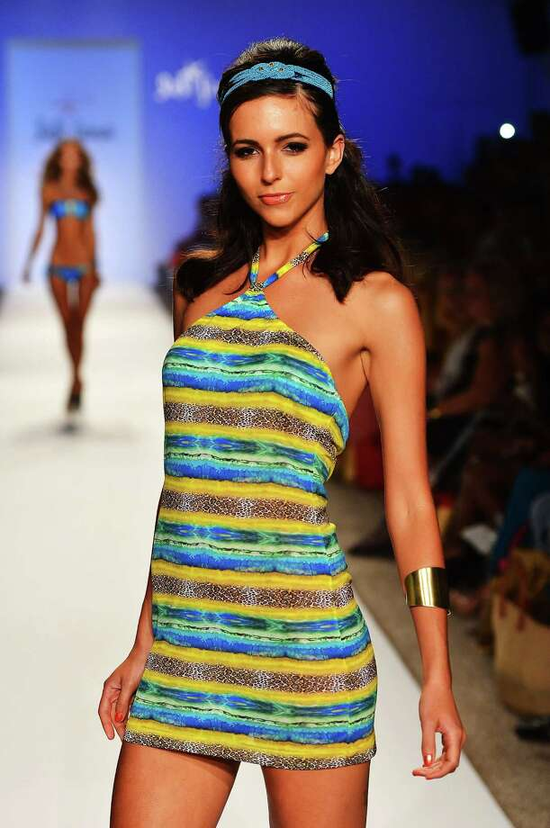 "A model walks the runway during the Luli Fama ""La Dolce Vita Miami"" Collection. Photo: Frazer Harrison, Getty Images For Luli Fama / 2012 Getty Images"