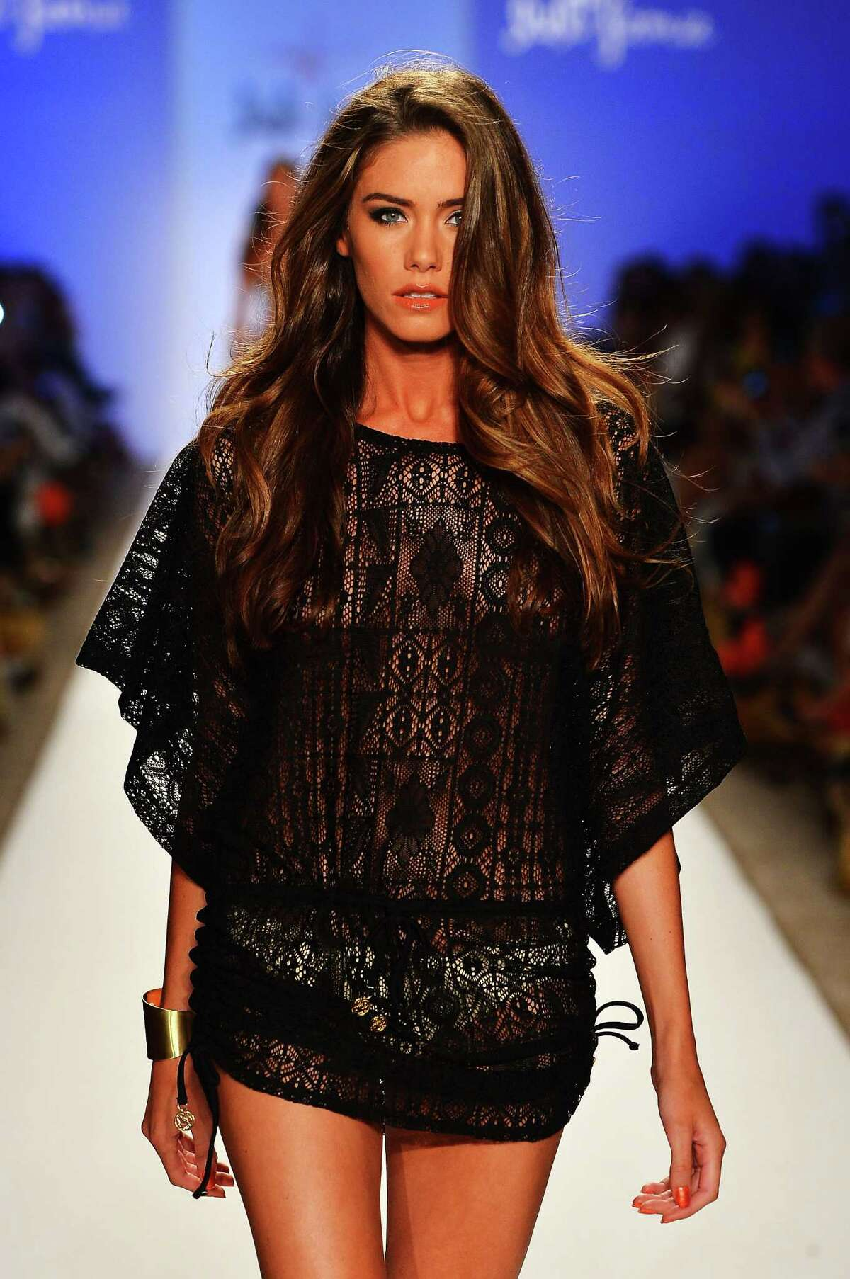 A model walks the runway during the Luli Fama