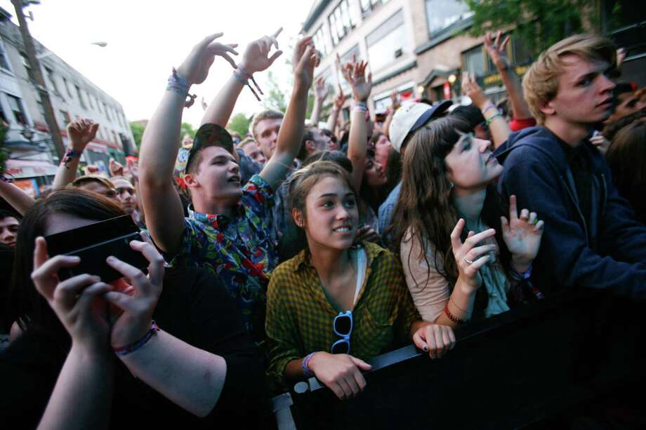 People throw their arms up as they listen to Phantogram. Photo: LINDSEY WASSON / SEATTLEPI.COM