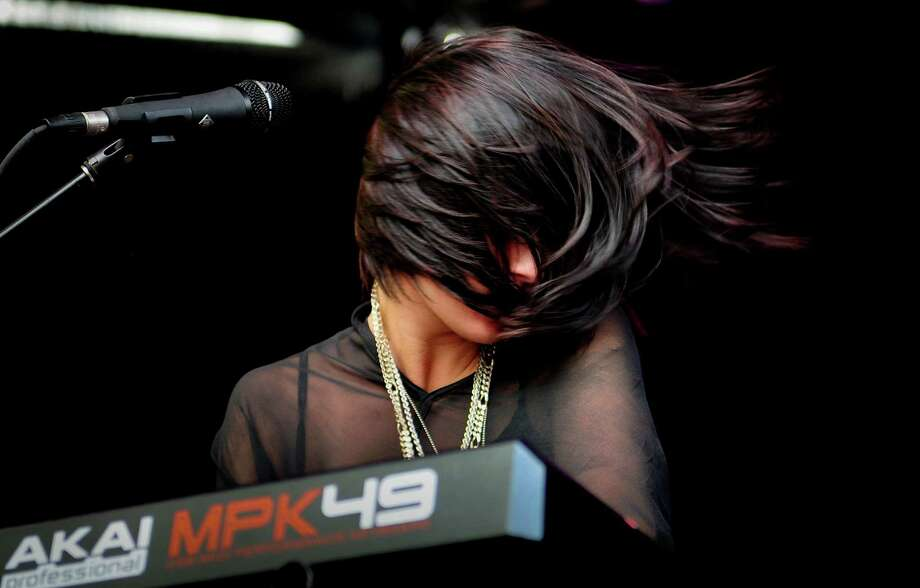 Sarah Barthel of Phantogram flips her hair as she plays the keyboard. Photo: LINDSEY WASSON / SEATTLEPI.COM