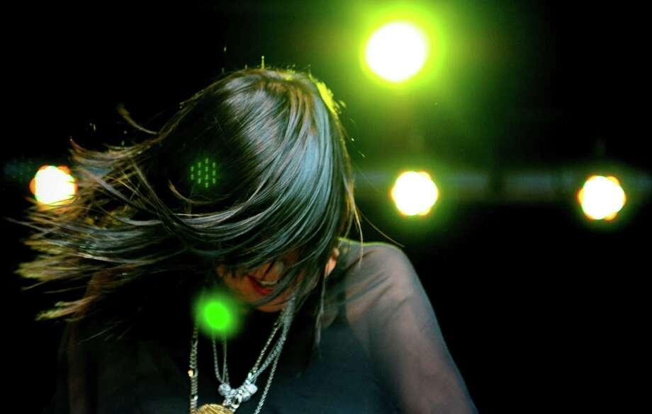 Sarah Barthel of Phantogram flips her hair as she plays the keyboard. Photo: LINDSEY WASSON / SEATTLEPI.COM