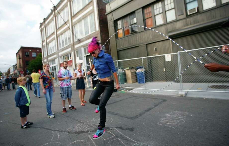 April O'Neil jumps through double dutch jump ropes. Photo: LINDSEY WASSON / SEATTLEPI.COM