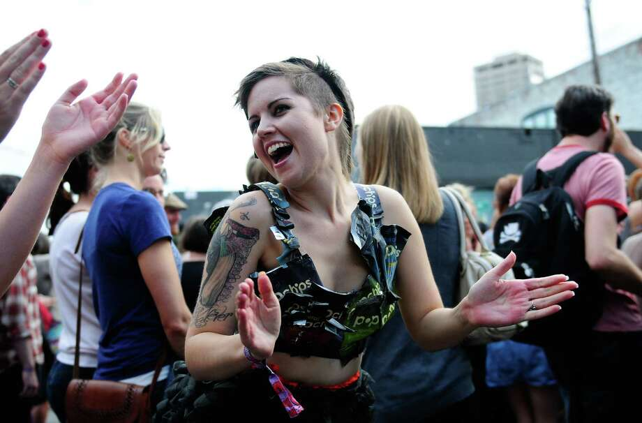 Morgan Carson, designer behind fashion startup Rene Ropas, dances while wearing a top made from Popchips bags. Photo: LINDSEY WASSON / SEATTLEPI.COM