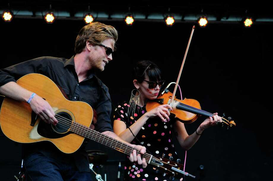 Wesley Schultz plays with a violinist as The Lumineers perform. Photo: LINDSEY WASSON / SEATTLEPI.COM