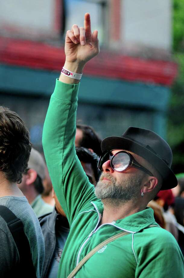 A partygoer lifts his hand to the sky as he listens to Phantogram. Photo: LINDSEY WASSON / SEATTLEPI.COM