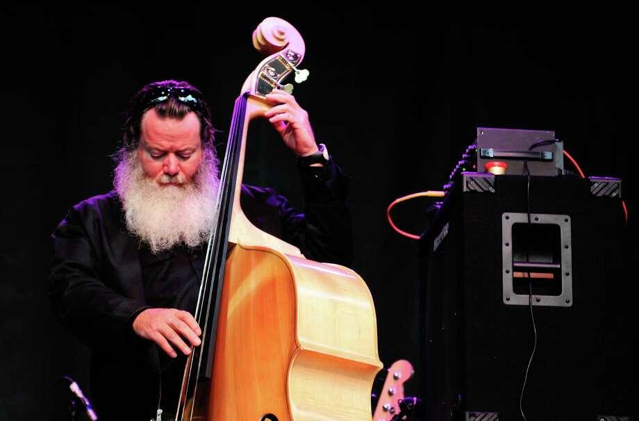 Neko Case's bass player plays a few notes. Photo: LINDSEY WASSON / SEATTLEPI.COM