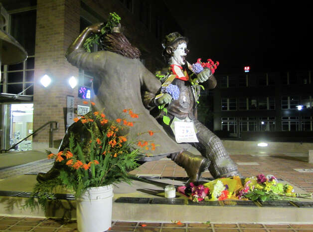 Signs and flowers were left on the J.P. Patches statue in Fremont on July 23, 2012, the day that the actor who played him, Chris Wedes, died at age 84. (Casey McNerthney/seattlepi.com)