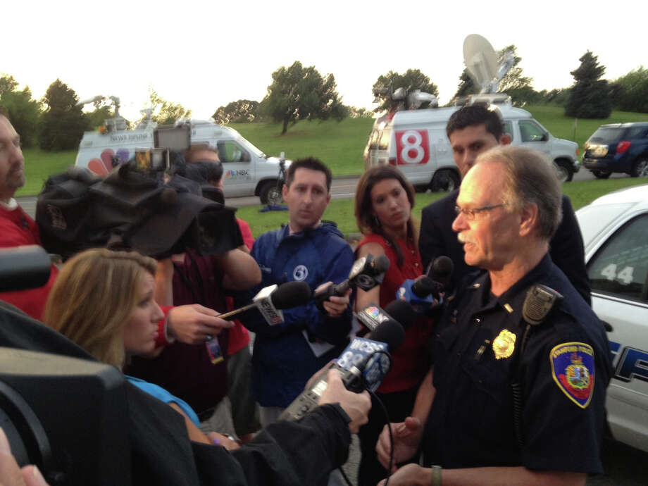 Stamford Police Lt. Phil Mazzucco briefs the media on an ongoing search for a man who was lost when the boat he was traveling on struck something off Stamford Harbor the morning of Monday, July 23, 2012. Mazzucco said a Coast Guard helicopter has suspended its search until a small incoming storm passes through the area. Photo: John Nickerson