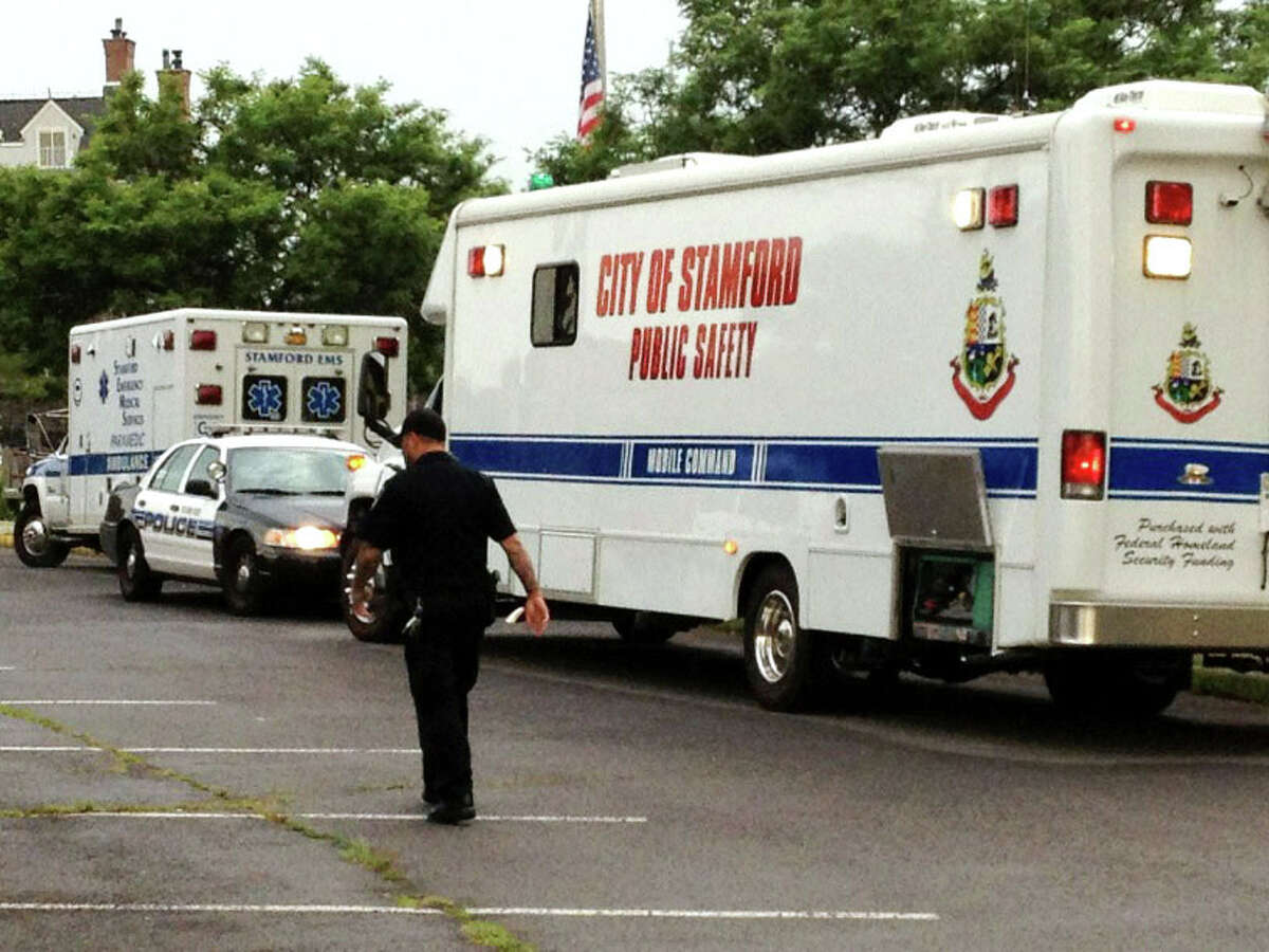 Stamford police set up a command center near Stamford Harbor the morning of Monday, July 23, 2012 to coordinate the search for a man who fell into the water when a boat capsized at about 11:30 p.m. the night of Sunday, July 22.