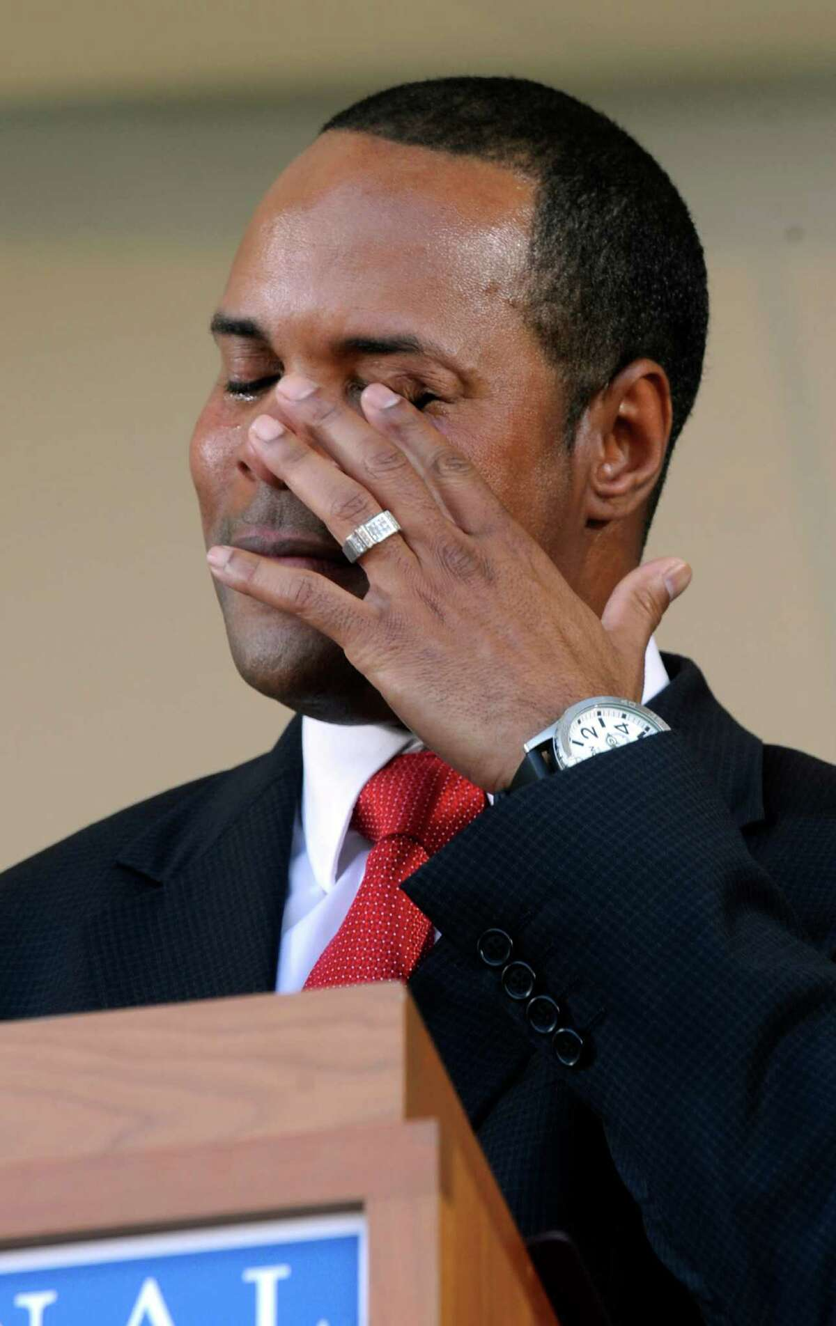 Former Cincinnati Reds star Barry Larkin wipes his eye as he gives his acceptance speech during his induction into the National Baseball Hall of Fame and Museum, Sunday, July 22, 2012, in Cooperstown, N.Y.
