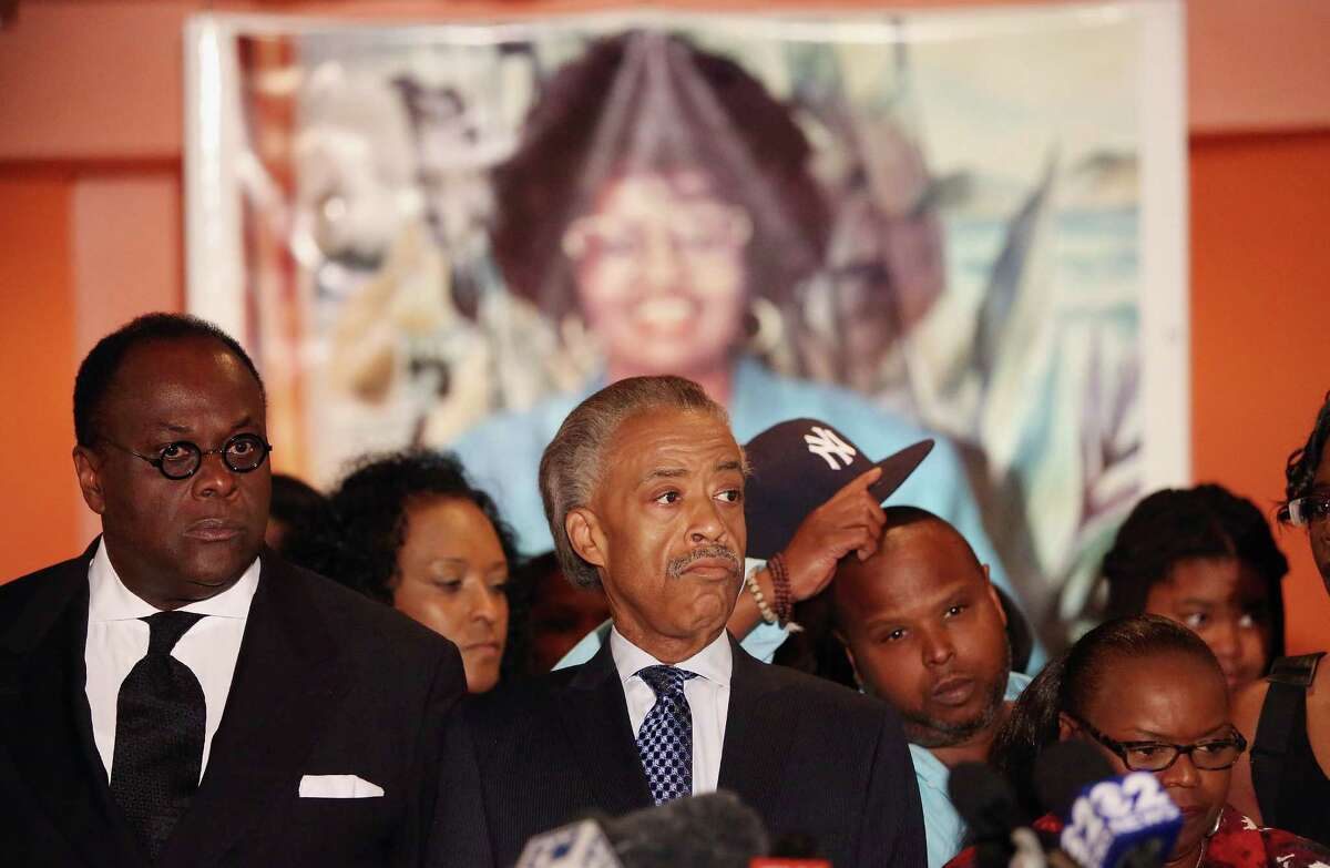 NEW YORK, NY - JULY 20: Rev. Al Sharpton (C) and Woods' family members gather at a press conference inside a section of Harlem restaurant Sylvia's after famed restaurateur and founder Sylvia Woods died yesterday on July 20, 2012 in the Harlem neighborhood of New York City. The Harlem soul food restaurant is a cultural icon and has been visited by dignitaries including U.S. Presidents Barack Obama and Bill Clinton.