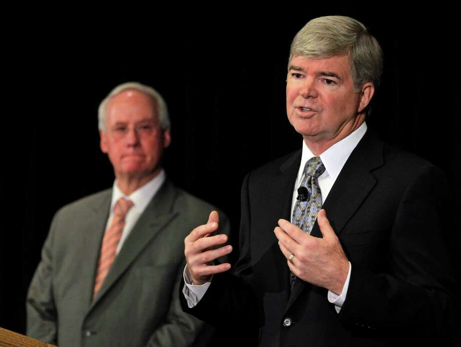 NCAA President Mark Emmert, right, gestures during a news conference as Ed Ray, NCAA Executive Committee chair and Oregon State University president,  looks on at left,  during a news conference in Indianapolis, Monday, July 23, 2012. The NCAA has slammed Penn State with an unprecedented series of penalties, including a $60 million fine and the loss of all coach Joe Paterno's victories from 1998-2011, in the wake of the Jerry Sandusky child sex abuse scandal.  (AP Photo/Michael Conroy) Photo: Michael Conroy, STF / AP