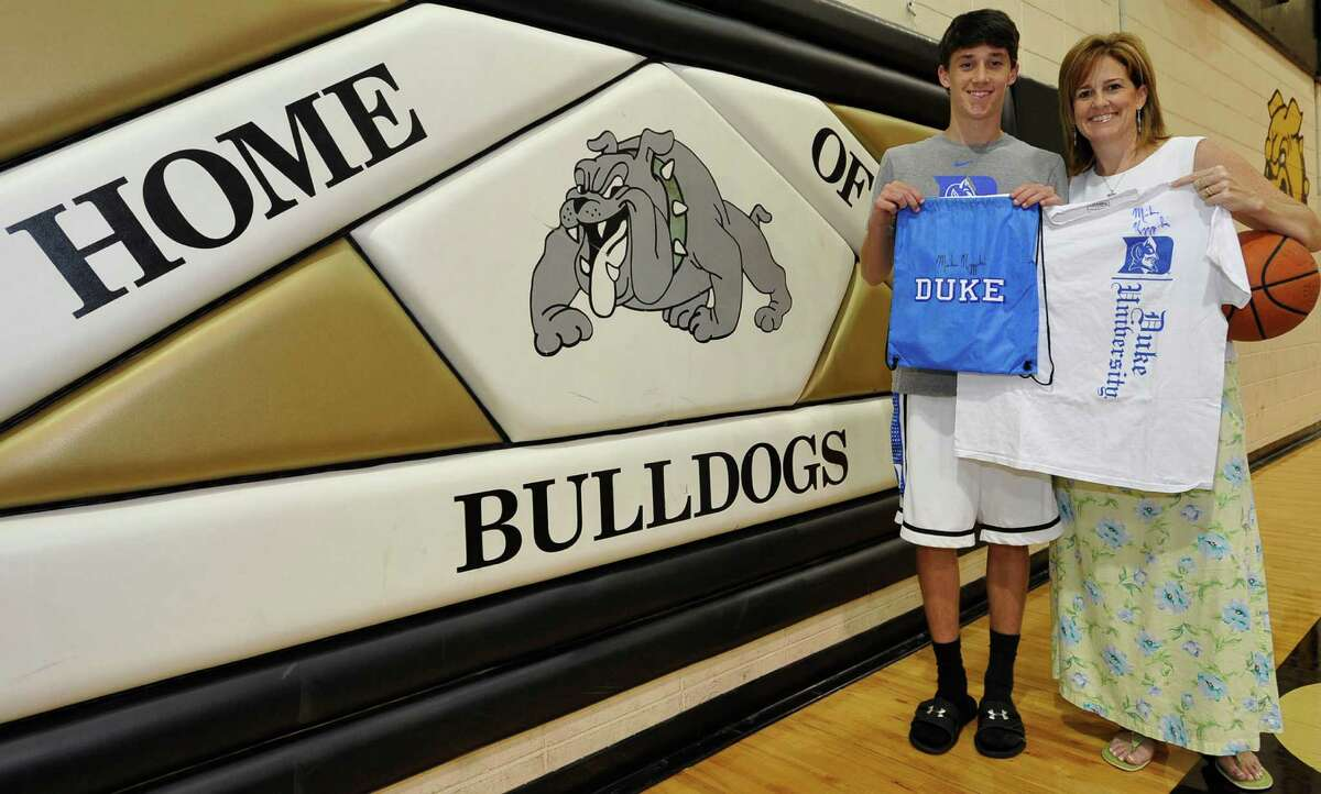 Nederland basketball player Kirby Hanley, left, and his mother, Shawn, will be guests of Duke basketball coach Mike Krzyzewski at a game this upcoming season. Hanley was attending the Duke basketball camp in late June when he and his mother had to leave early because his father was ill from cancer. Hanley's father died a few days later. Krzyzewski reached out to the family through email. Dave Ryan/The Enterprise