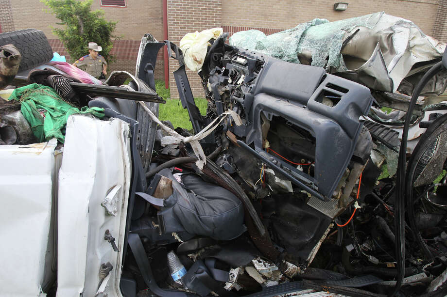 This is what's left of the cab of a 2000 Ford F-250 pickup truck after it crashed into a tree on the side of U.S. Highway 59 between Goliad and Beeville, Texas before 7:00 p.m. Sunday July 22, 2012. Thirteen people died in the accident and the truck was carrying more than 20 people when the accident took place. The truck is currentlly at the Goliad Sheriff's Office in Goliad, Texas. John Davenport/© San Antonio Express-News Photo: San Antonio Express-News