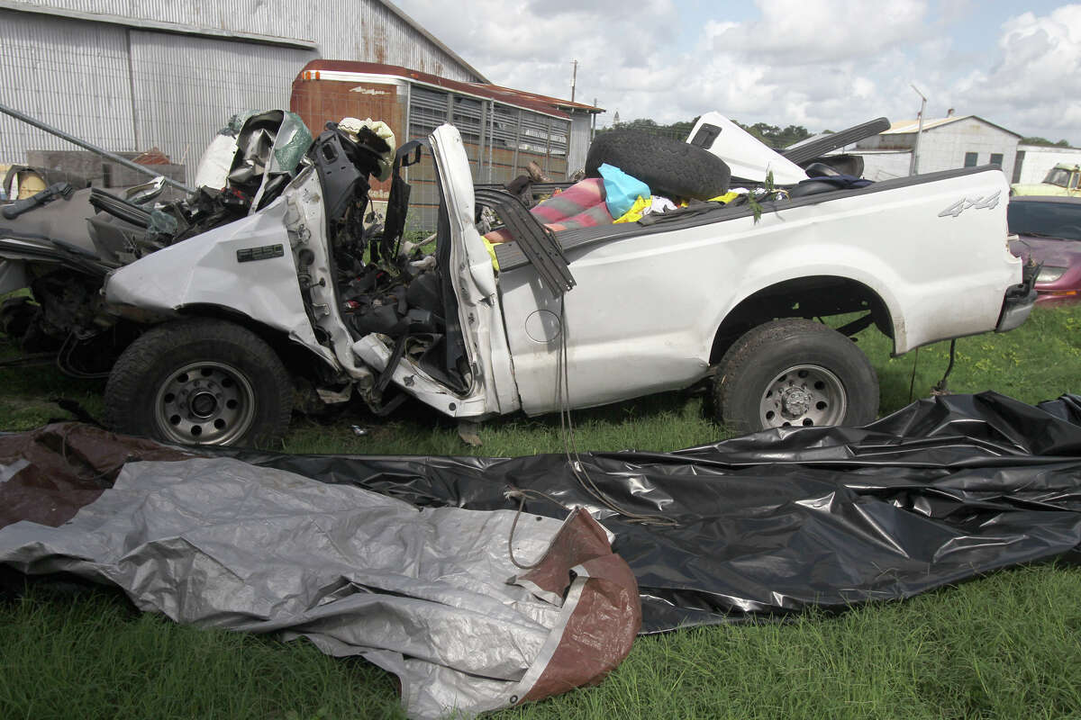 This is what's left of a 2000 Ford F-250 pickup truck after it crashed into a tree on the side of U.S. Highway 59 between Goliad and Beeville, Texas before 7:00 p.m. Sunday July 22, 2012. Thirteen people died in the accident and the truck was carrying more than 20 people when the accident took place. The truck is currentlly at the Goliad Sheriff's Office in Goliad, Texas. John Davenport/© San Antonio Express-News