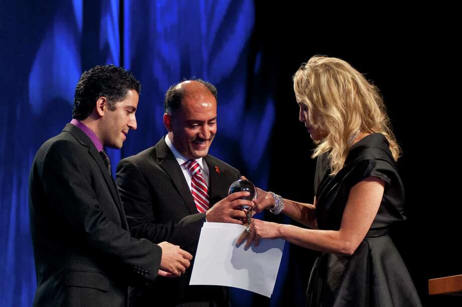 Sharon Stone presents the inaugural Elizabeth Taylor Award to brothers Dr. Arash Alaei and Dr. Kamiar Alaei on the opening day of the AIDS 2012 - XIX International AIDS Conference at the Walter E. Washington Convention Center on July 22, 2012, in Washington, DC. (Kris Connor/Getty Images) Photo: Kris Connor / 2012 Getty Images