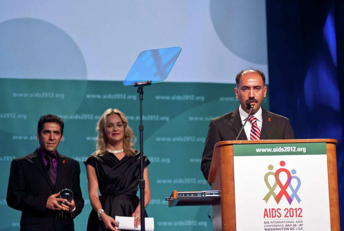 Dr. Kamiar Alaei, right, speaks after he and his brother Dr. Arash Alaei (L) were presented with the inaugural Elizabeth Taylor Award by actress Sharon Stone on the opening day of the AIDS 2012 - XIX International AIDS Conference at the Walter E. Washington Convention Center on July 22, 2012 in Washington, DC. (Kris Connor/Getty Images)