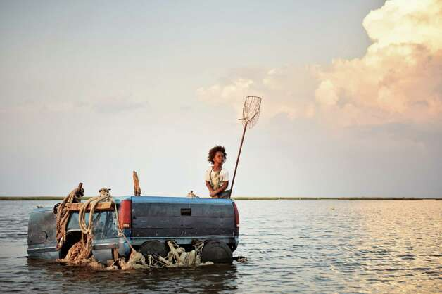 "Quvenzhane Wallis as ""Hushpuppy"" on the set of BEASTS OF THE SOUTHERN WILD. Photo: Jess Pinkham/Fox Searchlight"