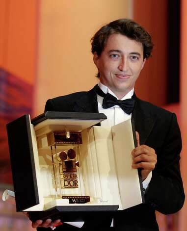 "Photo dated May 27, 2012 shows US director Benh Zeitlin after being awarded the Camera d'Or (Best First Film) for his film ""Beasts of the Southern Wild"" during the closing ceremony of the 65th Cannes film festival in Cannes. A cluster of tiny Louisiana towns being slowly swallowed by the encroaching sea was given new life in a fantastical film that has won top honors at Cannes and Sundance. Days before the wide release of ""Beasts of the Southern Wild, "" the crew came back to Montegut to show it to the people who fed them and housed them, built their sets and filled their supporting roles (Foto AP/Lionel Cironneau) Photo: Lionel Cironneau, STR / Copyright 2012 The Associated Press. All rights reserved. This material may not be published, broadcast, rewritten or redistribu"