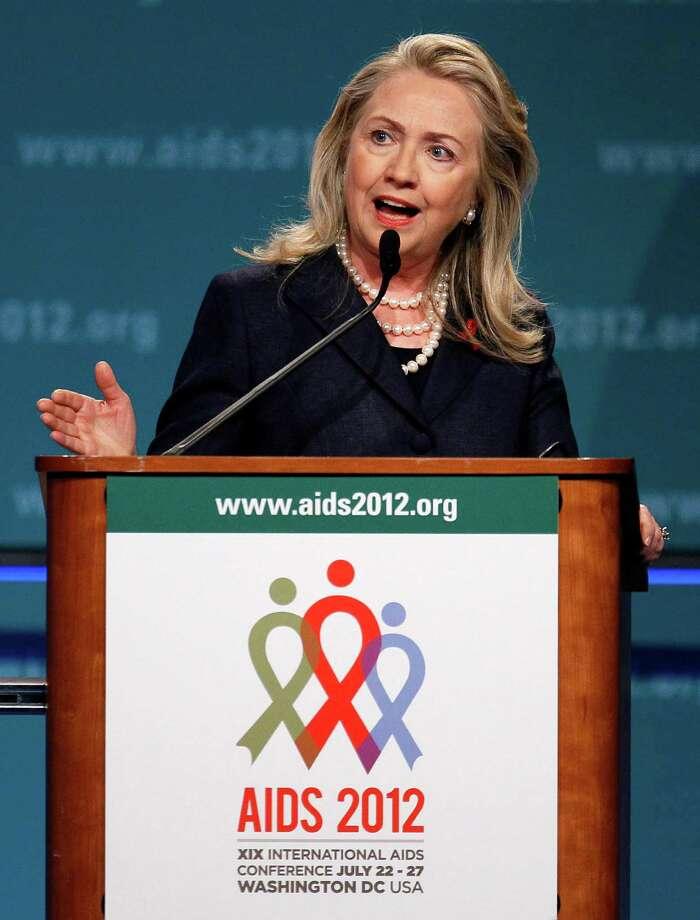 Secretary of State Hillary Rodham Clinton speaks at the XIX International Aids Conference, Monday, July 23, 2012, in Washington. (AP Photo/Carolyn Kaster) Photo: Carolyn Kaster / AP