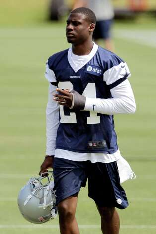 FILE - In this May 4, 2012, file photo, Dallas Cowboys' Morris Claiborne (24) walks the field during NFL football rookie camp at the team's training facility in Irving, Texas. As part of a symposium designed to ease their transition as pros, NFC rookies attended a seminar on health and safety hosted Monday, June 25, by Cleveland Browns team physician Dr. Mark Schickendantz. Schickendantz spoke on a number of topics, including concussions and potential long-term effects of head injuries, which have become a major focus for the league in recent years. Photo: AP