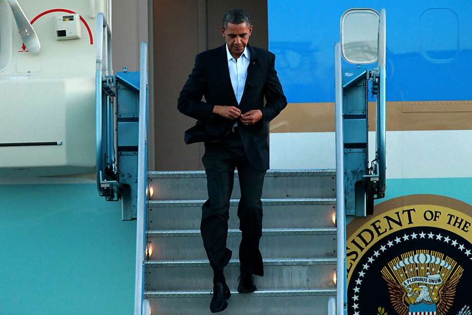 President  Obama salutes as he arrives in Air Force One, Sunday July 22, 2012, in San Francisco, Calif. Photo: Lacy Atkins, The Chronicle