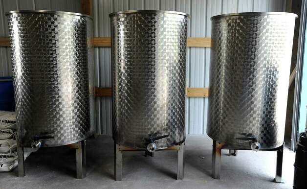 Tanks are in place in preparations for the Texas Big Beer Brewery to open in Buna, Texas. Photo: (AP Photo/The Beaumont Enterprise,  Tammy McKinley)