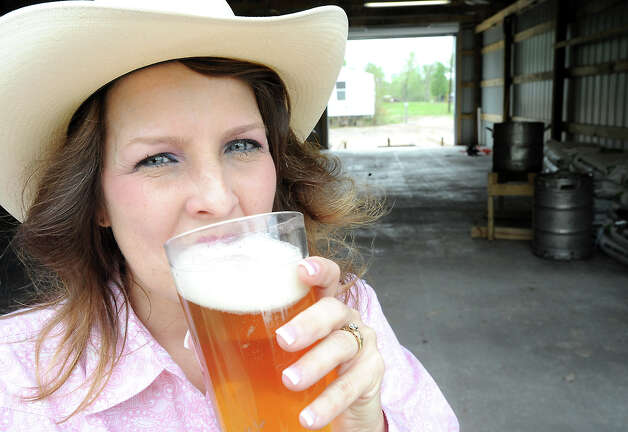Tammy McKissack drinks a beer and is one of the founders of the Texas Big Beer Brewery in Buna, Texas. Photo: (AP Photo/The Beaumont Enterprise,  Tammy McKinley)