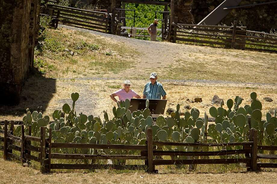 A couple looks at the experimental cactus garden at Jack London State Park in Glen Ellen, Calif., on Friday, July 13th, 2012. Photo: John Storey, Special To The Chronicle