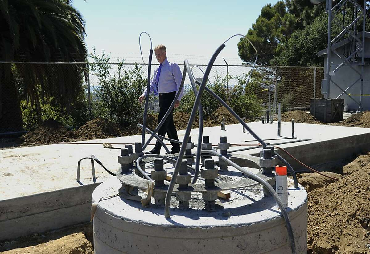 Willam J. McCammon, executive director of East Bay Regional Communications System, Authority, checks the new communications tower that is being built right next to a smaller existing tower on Thursday, July 19, 2012 in Oakland, Calif.