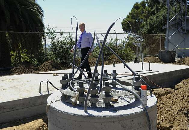 Willam J. McCammon, executive director of East Bay Regional Communications System, Authority, checks the new communications tower that is being built right next to a smaller existing tower on Thursday, July 19, 2012 in Oakland, Calif. Photo: Yue Wu, The Chronicle
