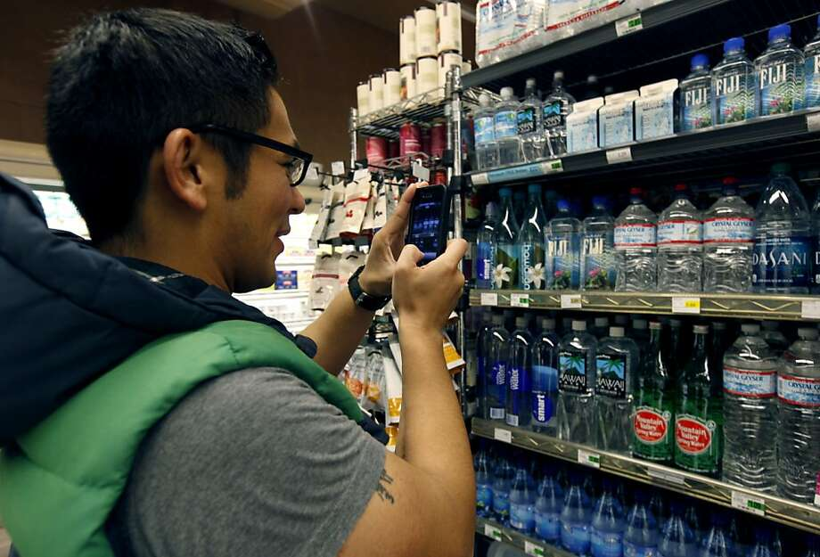 Fernando Navales collects information on bottled water using the Gigwalk marketing research app at Faletti Foods in San Francisco, Calif. on Friday, June 22, 2012. Photo: Paul Chinn, The Chronicle