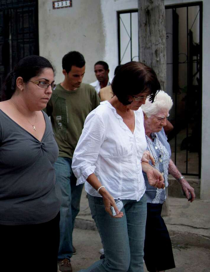 Relatives of the Cuban dissident Oswaldo Paya leave his house in Havana, Cuba, Sunday, July 22, 2012. Paya died in a car crash. He was 60 years old. Dissident Elizardo Sanchez says he confirmed Paya's death on Sunday with associates in the city of Bayamo, 500 miles (800 kilometers) east of the capital. (AP Photo/Ramon Espinosa) Photo: Ramon Espinosa / AP
