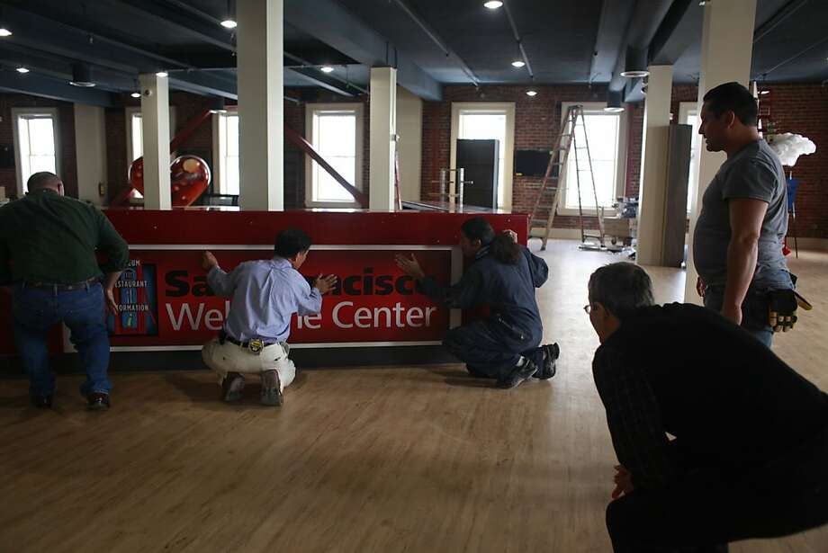 Workers ready the new San Francisco Welcome Center at 449 Powell Street for it opening party later this week, on Monday July 23, 2012 in San Francisco, Calif. Photo: Mike Kepka, The Chronicle