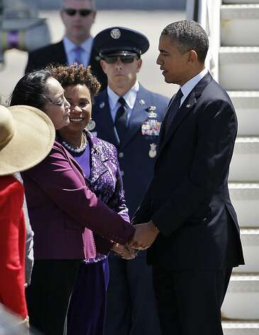 President Barack Obama, right, is greeted by Oakland Mayor Jean Quan, left, as Rep. Barbara Lee, D-Calif., center, watches as he arrives at the Oakland International Airport in Oakland, Calif., Monday, July 23, 2012. (AP Photo/Paul Sakuma) Photo: Paul Sakuma, Associated Press
