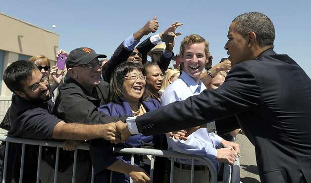 President Barack Obama greets people after arriving at Oakland International Airport in Oakland, Calif., Monday, July 23, 2012. (AP Photo/Susan Walsh) Photo: Susan Walsh, Associated Press