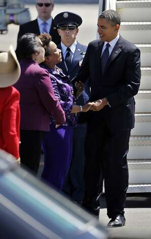 President Obama, right, is greeted by Rep. Barbara Lee, D-Calif., center, as Oakland Mayor Jean Quan, left, watches as he arrives at Oakland International Airport in Oakland, Calif., Monday, July 23, 2012. (AP Photo/Paul Sakuma) Photo: Paul Sakuma, Associated Press