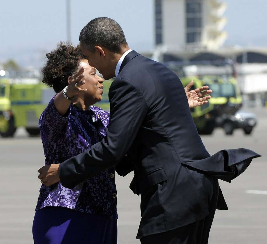 President Barack Obama gets a hug from Rep. Barbara Lee, D-Calif., after arriving at Oakland International Airport in Oakland, Calif., Monday, July 23, 2012. (AP Photo/Susan Walsh) Photo: Susan Walsh, Associated Press