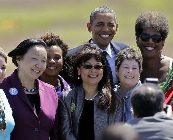 President Obama poses for photos with Oakland Mayor Jean Quan, left, and Rep. Barbara Lee, D-Calif., second from left, as he arrives at Oakland International Airport in Oakland, Calif., Monday, July 23, 2012. (AP Photo/Paul Sakuma) Photo: Paul Sakuma, Associated Press