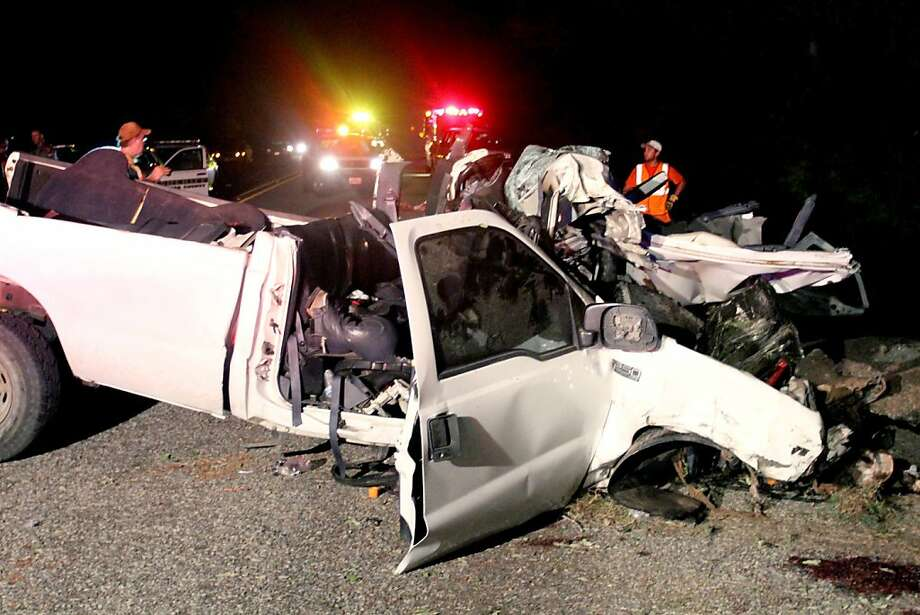 This July 22, 2012, photo shows a pickup truck that authorities say was overloaded with passengers  when it veered off a highway and crashed into trees near Goliad, Texas, killing at least 13 people and injuring 10. Officials said at least 23 passengers were crammed inside the truck's cab and bed, including at least two young children.  (AP Photo/The Victoria Advocate, Angeli Wright) Photo: Angeli Wright, Associated Press