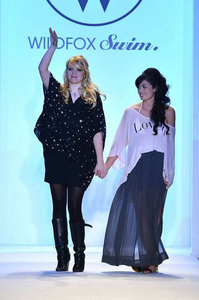 Designer Kimberley Gordon (L) and a model walk the runway at the Wildfox Swim show during Mercedes-B