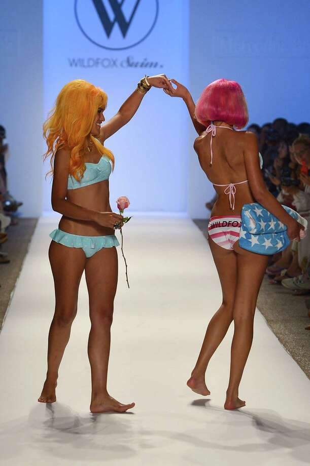 Models walk the runway at the Wildfox Swim show during Mercedes-Benz Fashion Week Swim 2013 at The Raleigh on July 23, 2012 in Miami Beach, Florida. Photo: Frazer Harrison, Getty Images For Wildfox Swim / 2012 Getty Images