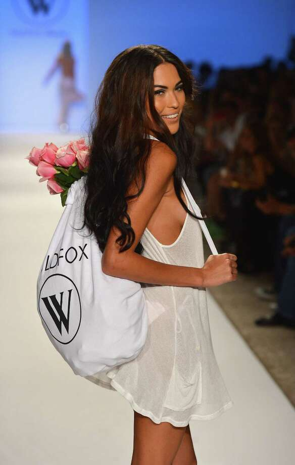 A model walks the runway at the Wildfox Swim show during Mercedes-Benz Fashion Week Swim 2013 at The Raleigh on July 23, 2012 in Miami Beach, Florida. Photo: Frazer Harrison, Getty Images For Wildfox Swim / 2012 Getty Images