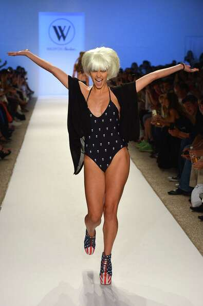 A model walks the runway at the Wildfox Swim show during Mercedes-Benz Fashion Week Swim 2013 at The
