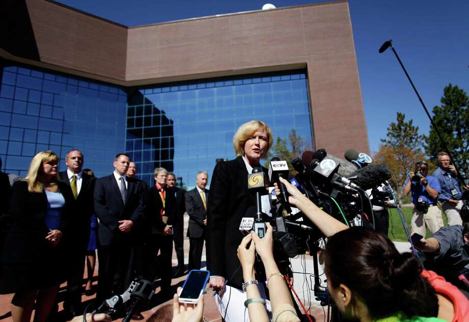 CENTENNIAL, CO - JULY 23: Arapahoe County District Attorney Carol Chambers talks to members of the news media before heading into the Arapahoe County Courthouse for suspect James Holmes' first court appearance July 23, 2012 in Centennial, Colorado. Chambers said the prosecutor's office would consult with family members when deciding whether or not to pursue the death penalty for James Holmes, 24, who is accused of killing 12 people and injuring 58 in a shooting spree July 20, during a screening of 'The Dark Knight Rises.' in Aurora, Colorado.  (Photo by Joshua Lott/Getty Images) Photo: Joshua Lott / 2012 Getty Images