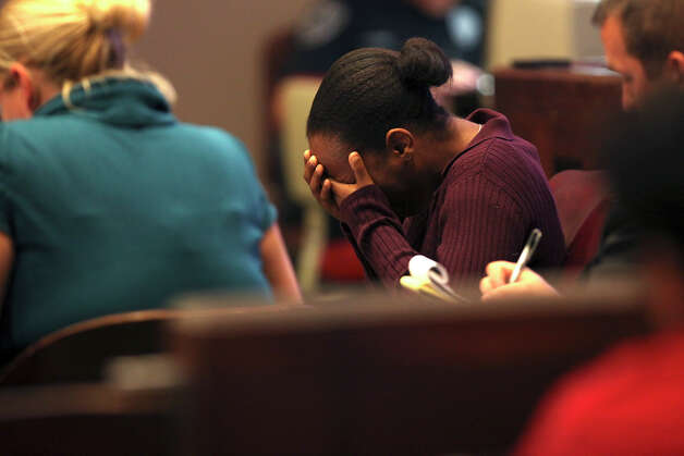 Tiffany James, 20, breaks down as the 911 tapes are played during her murder trial in the Bexar County 399th District Court, Monday, July 23, 2012. James is accused of murdering her boyfriend, Antwan Wolford in November 2009. He was also the father of her child. Photo: Jerry Lara, San Antonio Express-News / © 2012 San Antonio Express-News