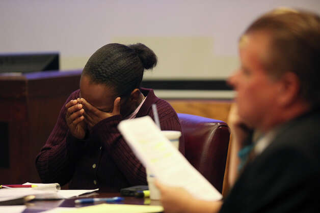 Tiffany James, 20, cries as the 911 tapes are played during her murder trial in the Bexar County 399th District Court, Monday, July 23, 2012. James is accused of murdering her boyfriend, Antwan Wolford during a domestic disturbance in November 2009. Photo: Jerry Lara, San Antonio Express-News / © 2012 San Antonio Express-News