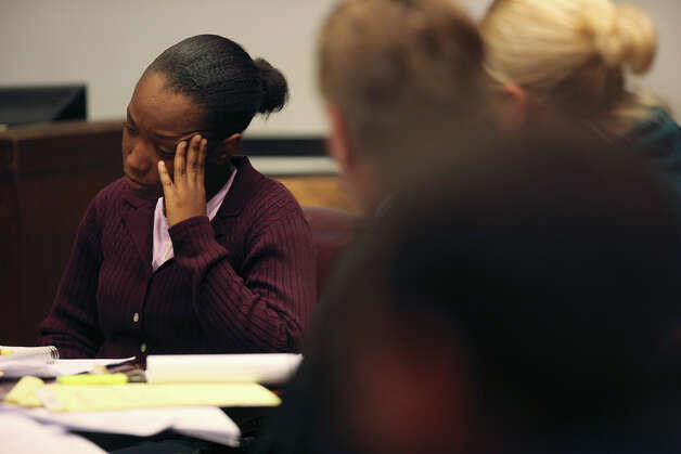 Tiffany James, 20, reacts as the prosecution introduces forensic evidence during her murder trial in the Bexar County 399th District Court, Monday, July 23, 2012. James is accused of murdering her boyfriend, Antwan Wolford in November 2009. Prosecutors rest their case late Monday. Photo: Jerry Lara, San Antonio Express-News / © 2012 San Antonio Express-News