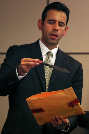 Prosecutor Christopher Ramos brings out a knife, introduced earlier as evidence, as he questions Bexar County Medical Examiner Jennifer Rulon during the murder trial of Tiffany James, 20, in the Bexar County 399th District Court, Monday, July 23, 2012. James is accused of stabbing and killing her boyfriend, Antwan Wolford, in November 2009. If convicted, James faces life in prison. Wolford was also the father of her child. Photo: Jerry Lara, San Antonio Express-News / © 2012 San Antonio Express-News